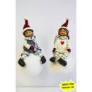 hurtownia Odziez dla dzieci i niemowlat: Chłopiec i  dziewczynka siedzi na kuli 14cm śniegu