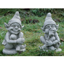 Two funny trolls /  gnomes sitting in a squatting p