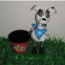 Dog with scarf and a flower pot