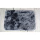 Un tapis 60x40 cm gris taché foncé