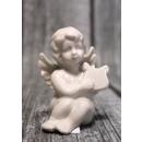 Statuetta di un angelo in ceramica seduto 10x6 cm
