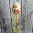 Uovo di Pasqua avvolto con giga sulla cima (10x7 c