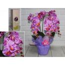 Fiore di orchidea artificiale in vaso di ceramica
