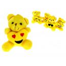 Mascot Teddy bear chiave gialla con un cuore con u