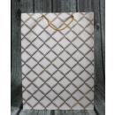Sacchetto regalo geometrico con motivi oro 42x31x