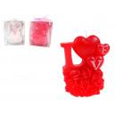 Valentijnsdag de liefde kaars met rozen in een doo