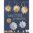 Książka: mini gwiazdki wykonane z papierowych tore
