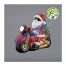 Święty Mikołaj na motocyklu z oświetleniem LED, ma