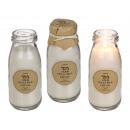 White scented candle (vanilla) in milk bottle