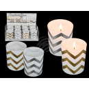 White candle in glass with metallic wave optics, a
