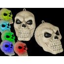 Plastic skull with color-changing LED (incl
