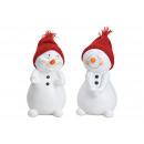 Pupazzo di neve con cappello a maglia rosso realiz