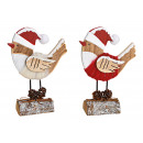 Display Christmas bird on tree trunk of wood,