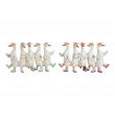 Gruppo di anatre di polietilene bianco, rosa, blu