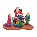Babbo Natale in miniatura con bambini in poli mult