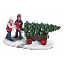 Bambini in miniatura con albero in una carriola in