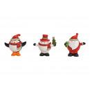 Święty Mikołaj, pingwin, bałwan w świątecznej czap