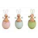 Conejito en un huevo de madera rosa / rosa, verde,