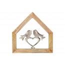 Uccello appeso a parete in metallo nella crema di