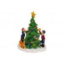 albero in miniatura con due figli e il cane da pol