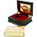 Golden playing cards in a wooden casket