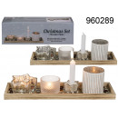 Festive set of candlesticks on a wooden podsta