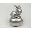 Bunny on egg, shiny metallic surface