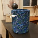 A container for toys, a basket, a laundry bag spac