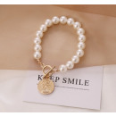 Artificial pearl bracelet with a B491 coin