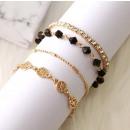 A set of 4 bracelets, gold circles B29