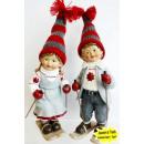 grossiste Figurines & Sclulptures: garçon et une  fille sur Poly ski 24cm