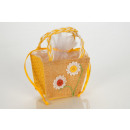 Organza bags in cup with flower motif