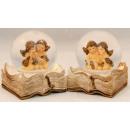 Schneekugeln mit Engel auf Buch, sortiert