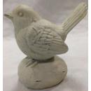 Vogelfigur auf Stein
