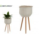white round planter with large legs