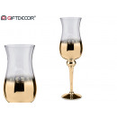 gouden en transparante grote glazen beker