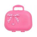 A toy makeup kit in a handbag