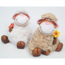 Sheep sitting with cuddly fur and metal flower