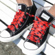 Laces in red with black stars